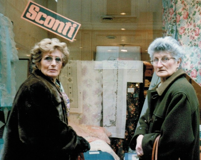two ladies in front a sale window